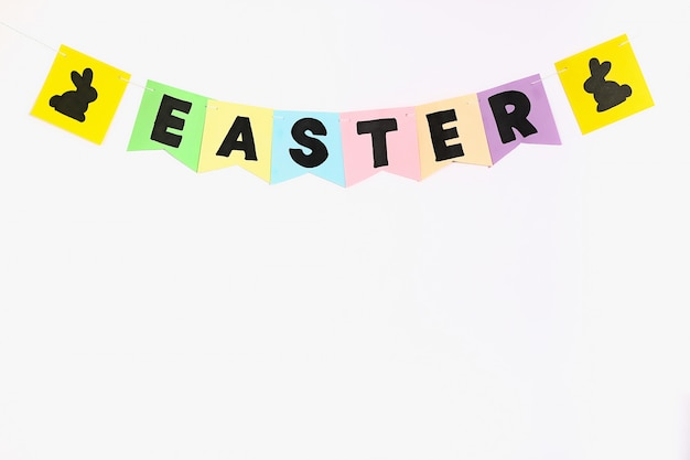 Diy easter garland, flags easter made paper blue background.