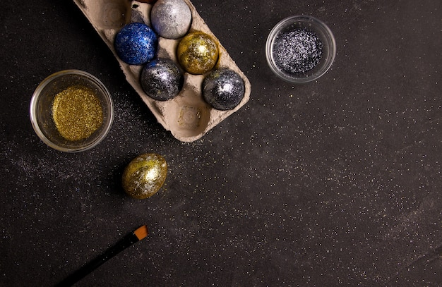 Diy for easter. shiny eggs on a black background.