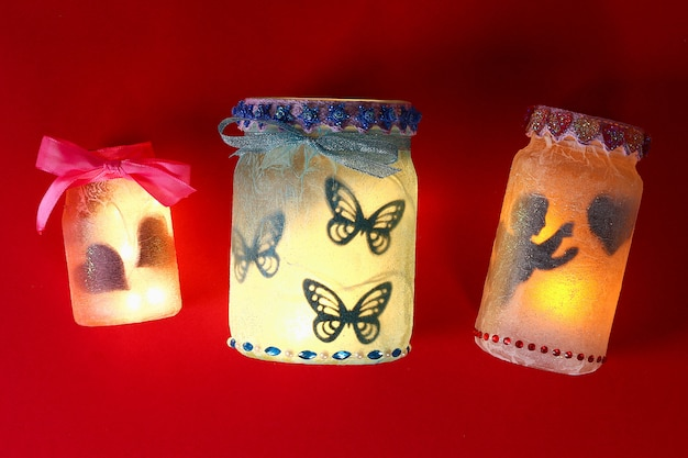Diy fairy jar on red background. gift ideas, decor february 14, st. valentines day, love.