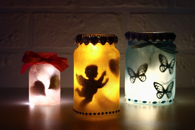 Diy fairy jar on white brick wall background. gift ideas, decor st february 14, valentine's day