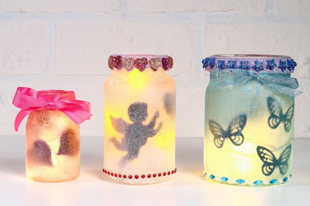 Diy fairy jar on white brick wall background. gift ideas, decor st february 14