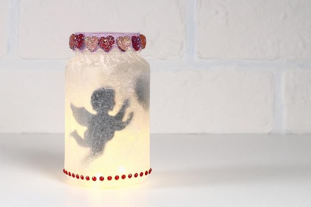 Diy fairy jar on white brick wall background. gift ideas