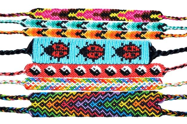 Diy friendship bracelets handmade of embroidery thread on white