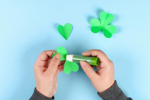 Diy green clover st. patricks day on blue background.