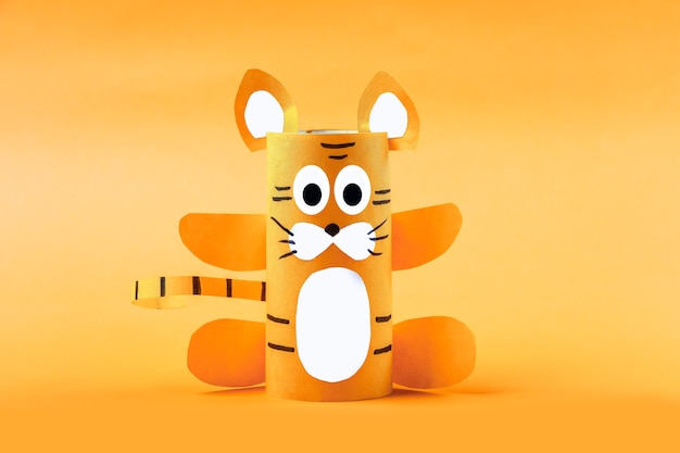 Diy and kid's creativity. step by step instruction: how to make symbol of 2022 of tiger from toilet roll tube. step3 finished craft. children new year and christmas craft .
