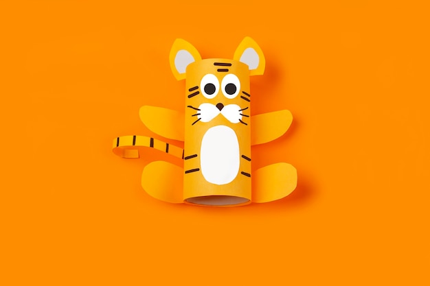 Diy and kid's creativity. step by step instruction: how to make symbol of 2022 of tiger from toilet roll tube. step3 finished craft. children new year and christmas craft.
