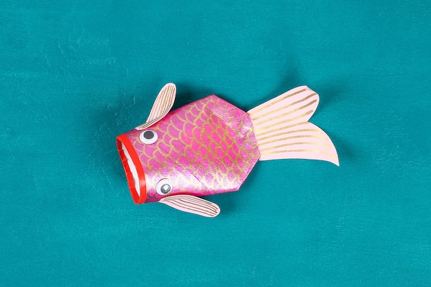 Diy koi carp fish on blue green background.