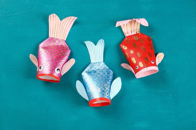 Diy koi carp fish on blue green background.