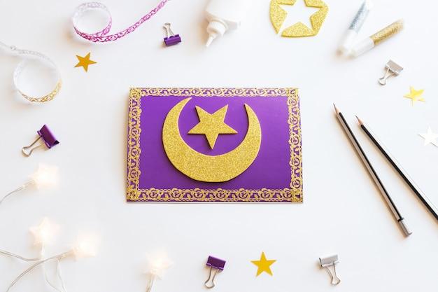 Diy ramadan kareem card with golden crescent moon and a star.