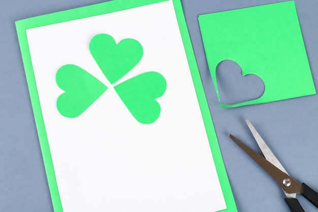 Diy st patricks day greeting card made cardboard and paper clovers gray background