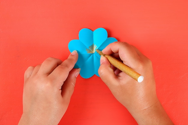 Diy three-dimensional 3d greeting card with flowers for mothers day on a living coral background.