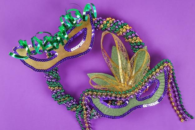 Diy wreath mardi gras, fat tuesday purple background.