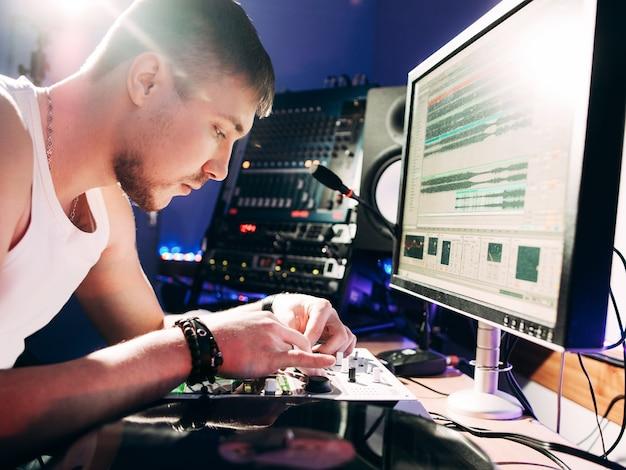 Dj adjusting music equipment before work