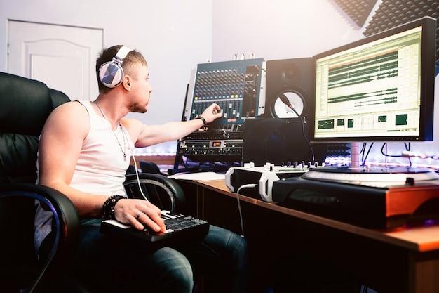 Dj adjusting sound in recording studio