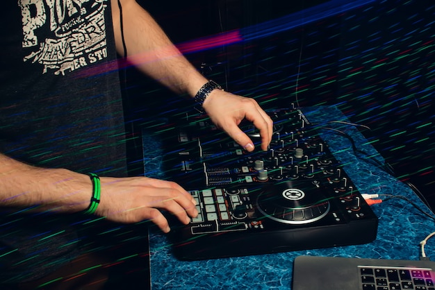 Dj in booth playing in nightclub