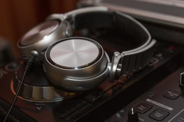 Dj headphones on soundmixer. big night life.