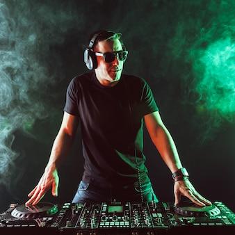 Dj mixing music on mixer