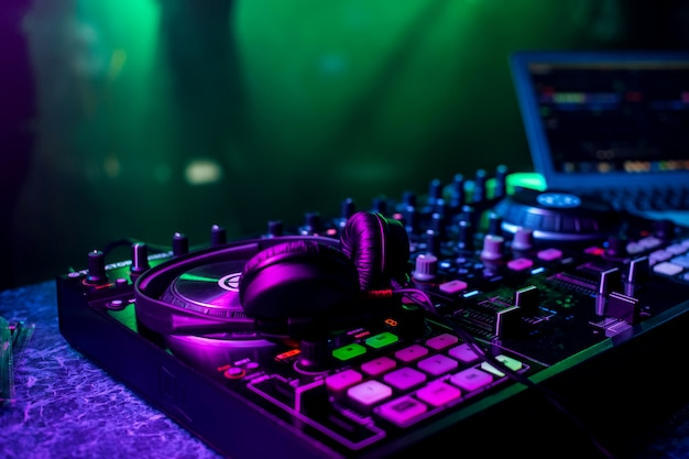 Dj music mixer and professional headphones in the nightclub