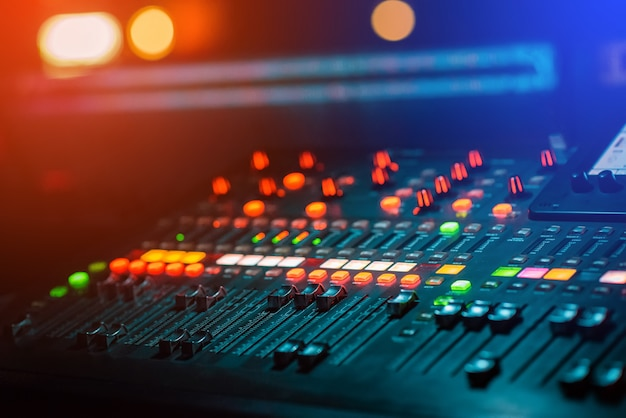 Dj music mixing console with light bokeh