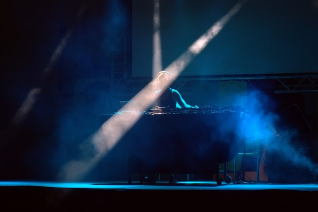 Dj performing on a stage