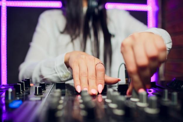 Dj playing music mixer closeup