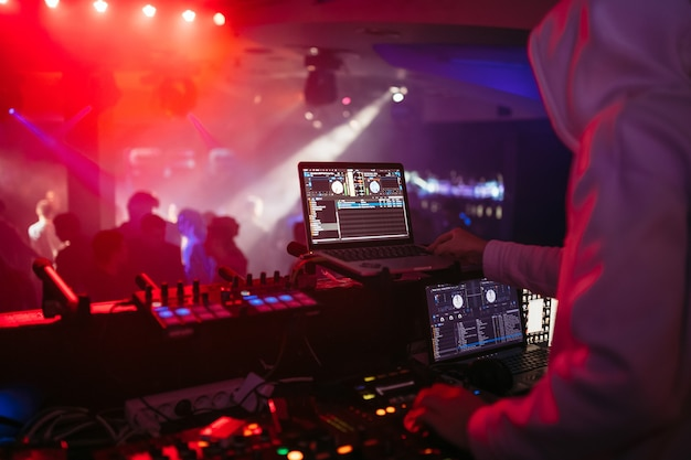 Dj plays music in the club