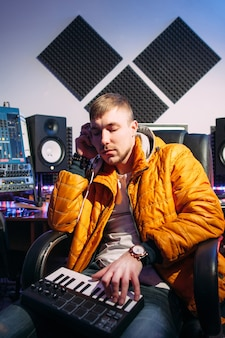 Dj recording music in sound studio.