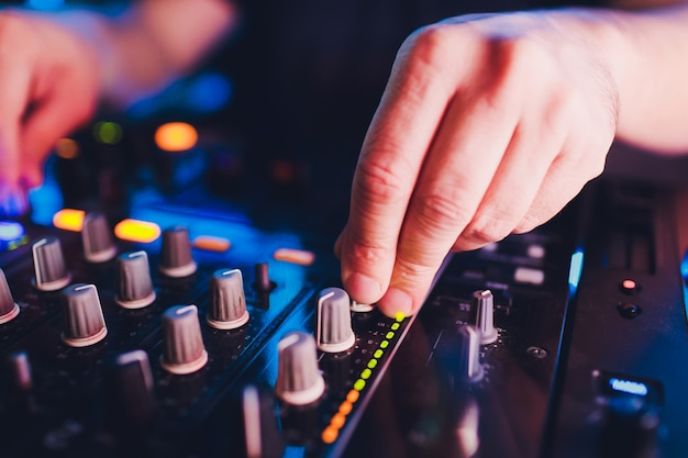 Dj remote, turntables, and hands . night life at club, party.