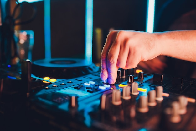 Dj remote, turntables, and hands . night life at the club, party.