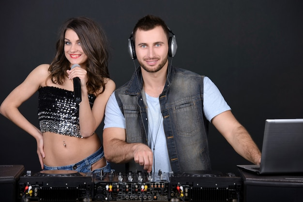 Dj and techno party girl isolated on a dark