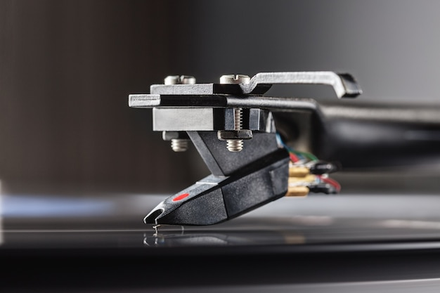 Dj turntable for vinyl records, cartridge on tonearm and space for text.