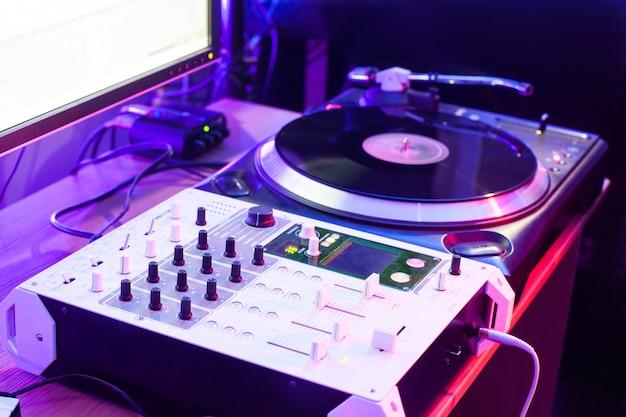 Dj vinyl player mixer in night club