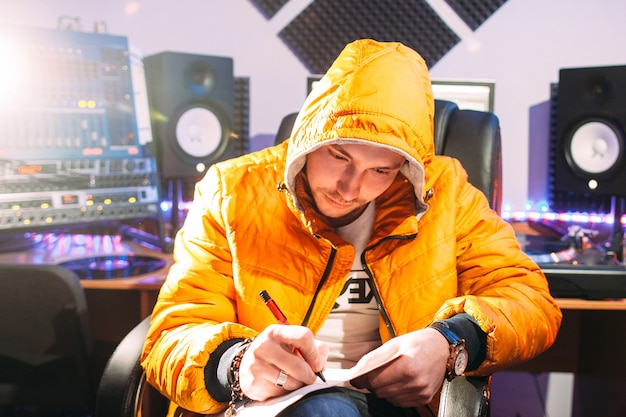 Dj writing new lyrics in recording studio
