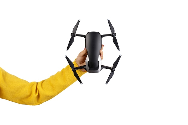 Dji mavic air in hand, isolated on a white background