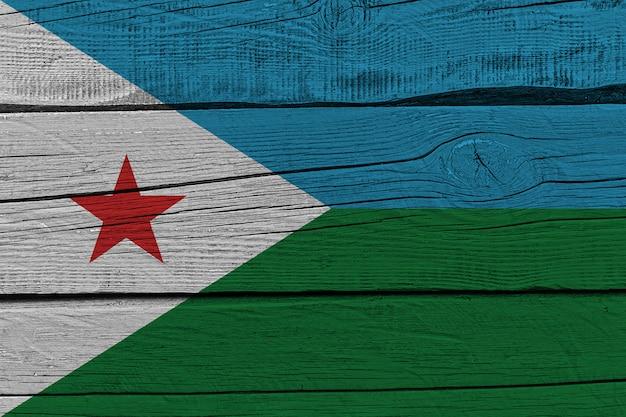 Djibouti flag painted on old wood plank