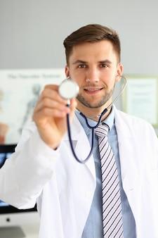 Doc holding stethoscope