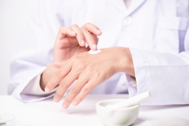 Doctor applying hand cream