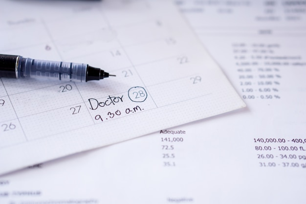 Doctor appointment remind note on calendar with date and time for examination