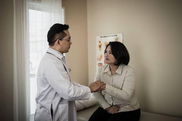 Doctor assisted the patient during his health check-up at the hospital.