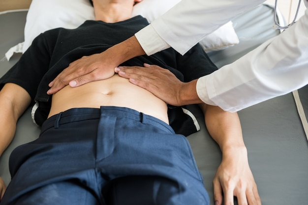 Doctor check stomach of patient in hospital