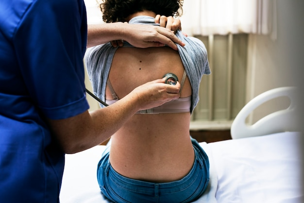 Doctor checking a breathing of a patient