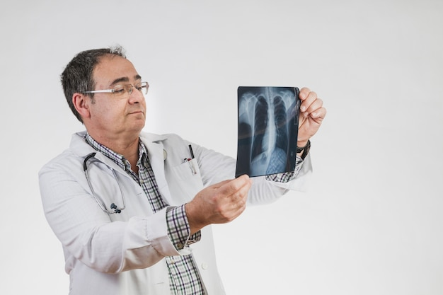 Doctor checking x ray scan
