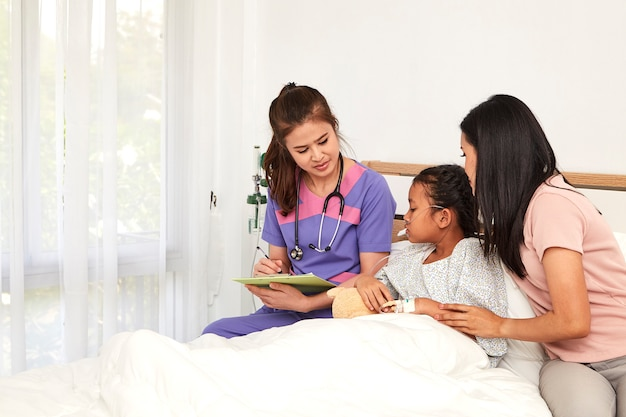 Doctor and child with mother in hospital