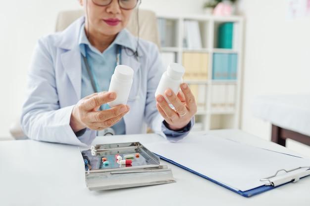 Doctor choosing medicine