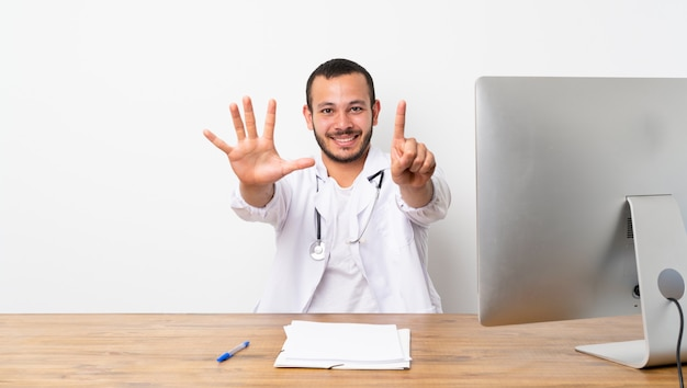Doctor colombian man counting six with fingers
