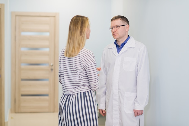 Doctor comforting patient at hospital