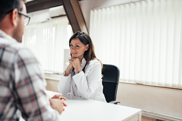 Doctor in consultation with male patient in the office.