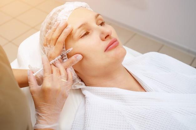 Doctor-cosmetician injects gel-like medicine under skin