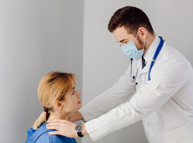 Doctor examines the patient . medicine and health care concept.