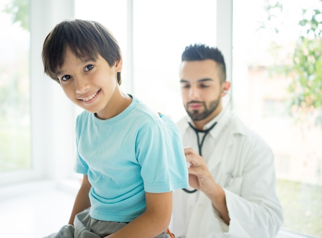 Doctor examining a boy at hospital